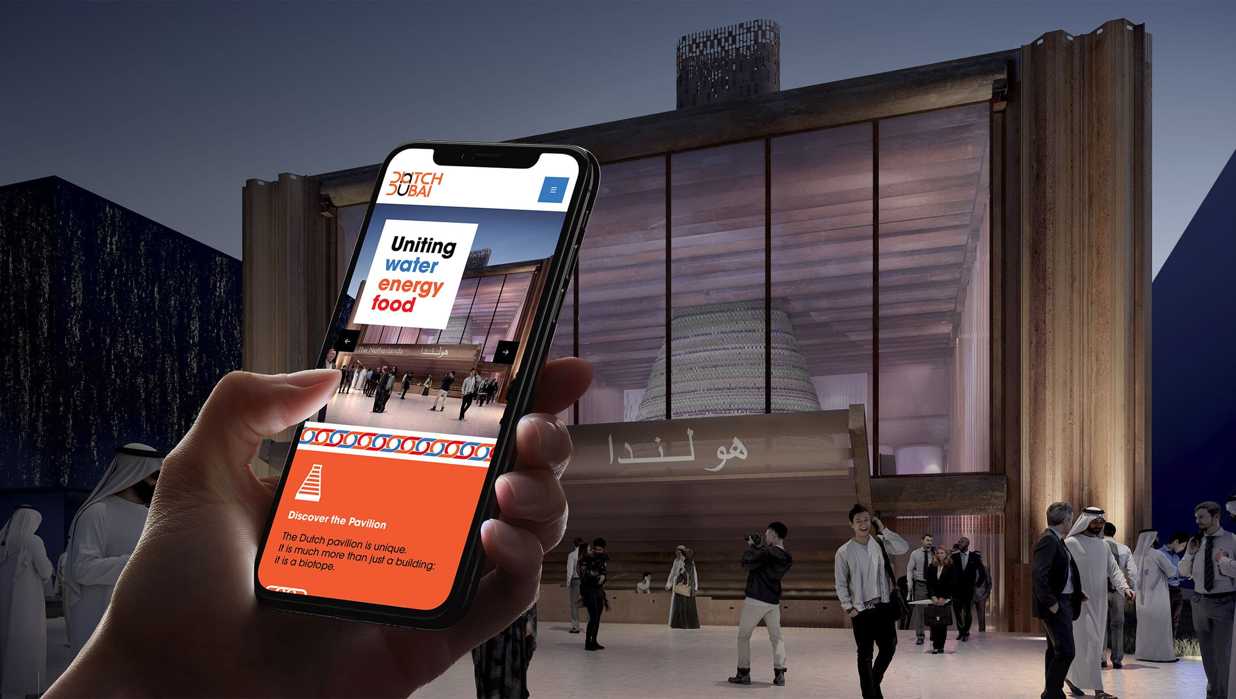 Person looking at Dutch Dubai websites on their mobile in front of pavilion